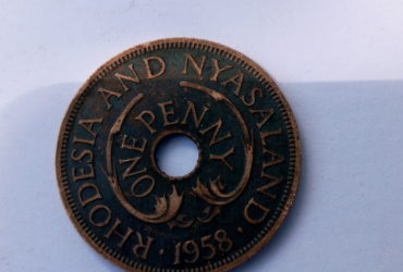 1958 ONE PENNY .RHODESIA AND NYASA LAND  . QUEEN ELIZABETH THE SECOND